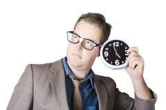 Businessman Holding Clock Near Ear Stock Photos