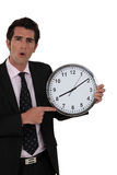 Businessman holding clock Royalty Free Stock Photo