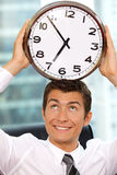 Businessman holding clock to his head Royalty Free Stock Photo