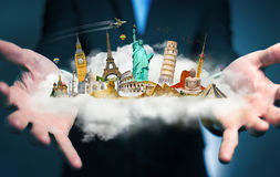 Businessman holding a cloud full of famous monuments in his hand. Businessman on blurred background holding a cloud full of famous monuments in his hands 3D Stock Images