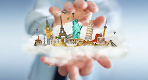 Businessman holding a cloud full of famous monuments in his hand. Businessman on blurred background holding a cloud full of famous monuments in his hands 3D Stock Image
