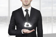 Businessman holding cloud security symbol Royalty Free Stock Photos