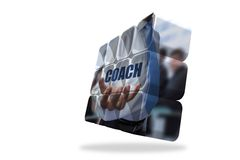 Businessman holding coach text on abstract screen Royalty Free Stock Images