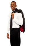 Businessman holding coat over his shoulders Stock Image
