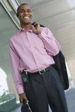 Businessman Holding Coat Over Shoulder Royalty Free Stock Photography