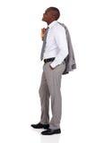 Businessman holding coat Royalty Free Stock Image