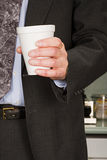 Businessman holding coffee cup Royalty Free Stock Photo