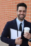 Businessman holding coffee cup and folder with documents smiling Stock Photos