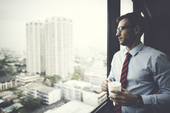 Businessman Holding coffee Thinking Relax Concept.  Stock Images
