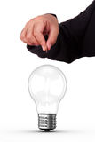 Businessman Holding Coin and Light Bulb Royalty Free Stock Photo