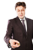 Businessman holding coins in his hand isolated Royalty Free Stock Photos