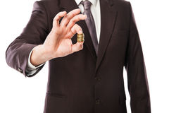 Businessman holding coins in his hand isolated Stock Images