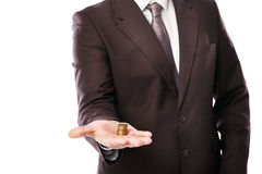 Businessman holding coins in his hand isolated Stock Photos