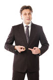 Businessman holding coins in his hand isolated Royalty Free Stock Images
