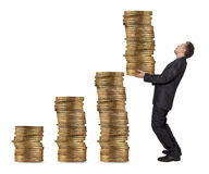 Businessman holding coins Stock Images