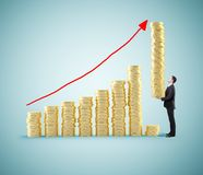 Businessman holding coins. Businessman with tower of coins building chart coins Royalty Free Stock Image