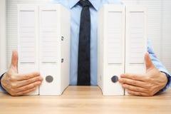 Businessman holding company documentation,  Stock Images