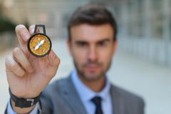 Businessman holding a compass  Stock Photography