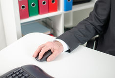 Businessman holding a computer mouse Stock Photography