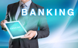 Businessman holding computer tablet in hand and show BANKING Stock Photos