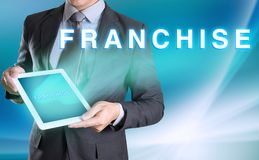 businessman holding computer tablet in hand and show FRANCHISE w stock photography