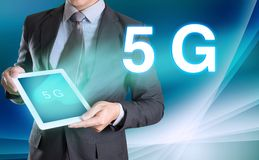 businessman holding computer tablet in hand and show 5G, technology royalty free stock photography