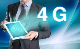 businessman holding computer tablet in hand and show 4G, technology stock image