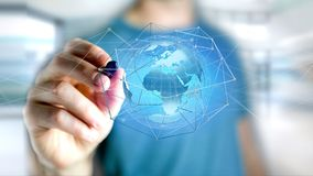 Businessman holding a Connected network over a earth globe conce. View of a Businessman holding a Connected network over a earth globe concept on a futuristic Stock Photography