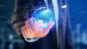 Businessman holding a Connected network over a earth globe conce. View of a Businessman holding a Connected network over a earth globe concept on a futuristic Stock Images
