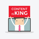 Businessman holding Content is King sign in computer notebook Stock Image