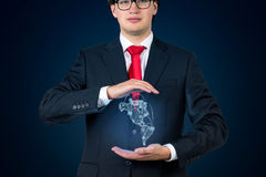 Businessman holding continent Americaon Stock Image
