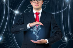 Businessman  holding continent Americaon Stock Photos