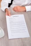 Businessman holding contract paper Stock Photos
