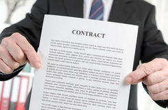 Businessman holding a contract Stock Image