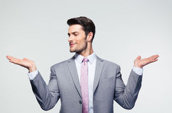 Businessman holding copyspace on the palms Stock Images