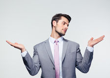 Businessman holding copyspace on the palms Royalty Free Stock Photography