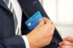 Businessman holding credit card. Royalty Free Stock Photo