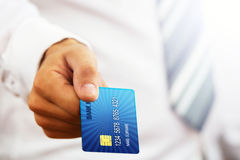 Businessman holding credit card. Stock Photography
