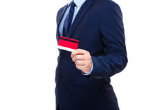 Businessman holding credit card. Isolated on white Royalty Free Stock Photo
