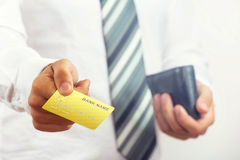 Businessman holding credit card. Stock Images