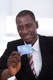 Businessman holding credit card Stock Image