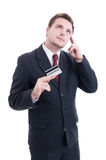 Businessman holding credit card and thinking at costs Stock Photos