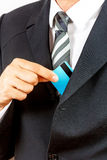 Businessman holding credit card. Royalty Free Stock Photography