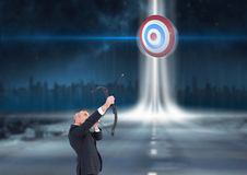 Businessman holding a cross bow and aiming at the target board Royalty Free Stock Photography