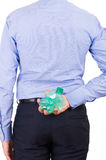 Businessman holding crushed bottle behind his back. Stock Images