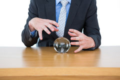 businessman holding a crystal ball Stock Images