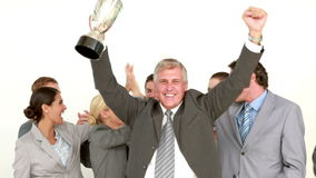 Businessman holding cup and cheering with his colleagues stock footage