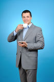 Businessman holding cup of coffee Royalty Free Stock Images