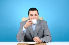 Businessman holding cup of coffee Royalty Free Stock Photo