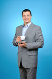 Businessman holding cup of coffee Stock Photos
